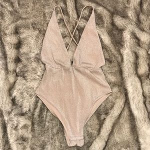 Blush pink shimmer body suit